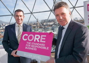 Niall Martindale, Director of Regulation and Pricing for firmus energy is presented with the Silver CORE accreditation by Kieran Harding, Managing Director of Business in the Community NI, recognising firmus energy's achievement and commitment to Corporate