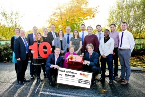 Image: staff from firmus energy presenting a cheque to Shine NI
