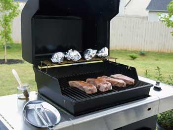 Image: cooking steaks with a natural gas bbq