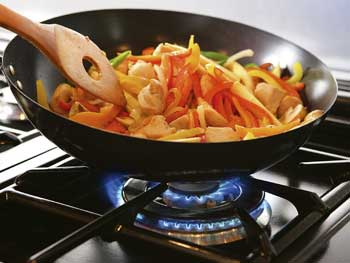 Image: wok cooking using natural gas cooker